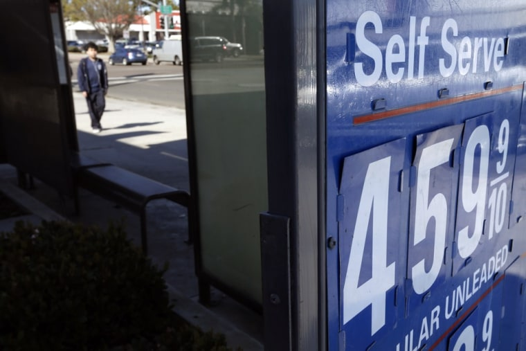 A gas station displays a price of $4.59 for a gallon of self-service regular gas Friday, Feb. 22, 2013, in San Diego.
