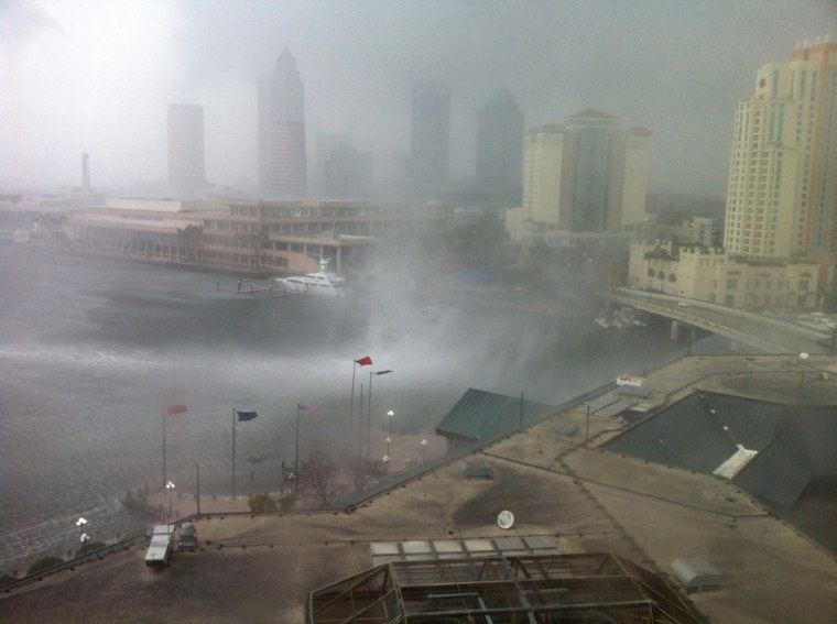 A waterspout causes damage as it comes ashore on Harbour Island in Tampa, Fla.