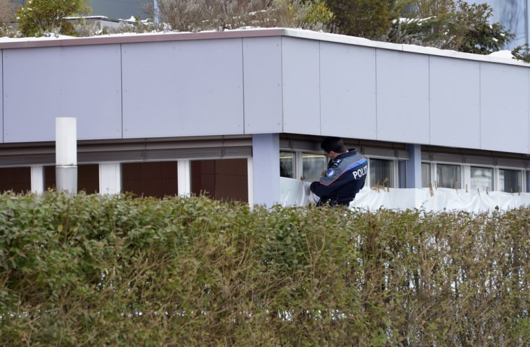 Police can be seen at the site of a Wednesday shooting in Menznau, Switzerland. Three people, including the gunman, died in a shooting at factory during a morning break in the cafeteria, a witness told local newspaper Neue Luzerner Zeitung.