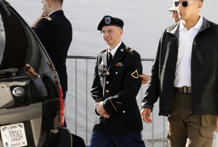 Army Pfc. Bradley Manning is escorted in handcuffs as he leaves the courthouse in Fort Meade, Maryland, on June 6.