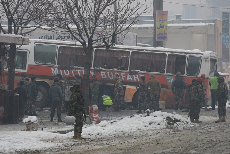 Afghan National Army soldiers investigate the scene following a suicide attack against a bus carrying Afghan army personnel in Kabul on Wednesday.