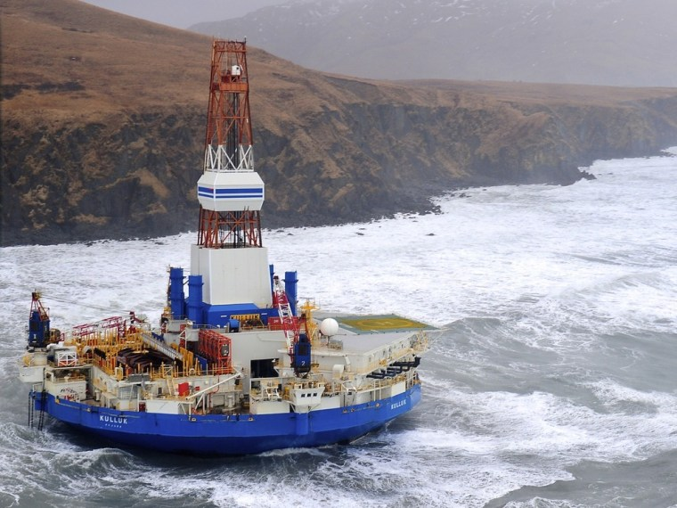 An aerial image provided by the U.S. Coast Guard shows the Royal Dutch Shell drilling rig Kulluk aground off a small island near Kodiak Island on Jan. 1. Shell announced Wednesday that it had put off further drilling in Alaska's Arctic Ocean for the year.