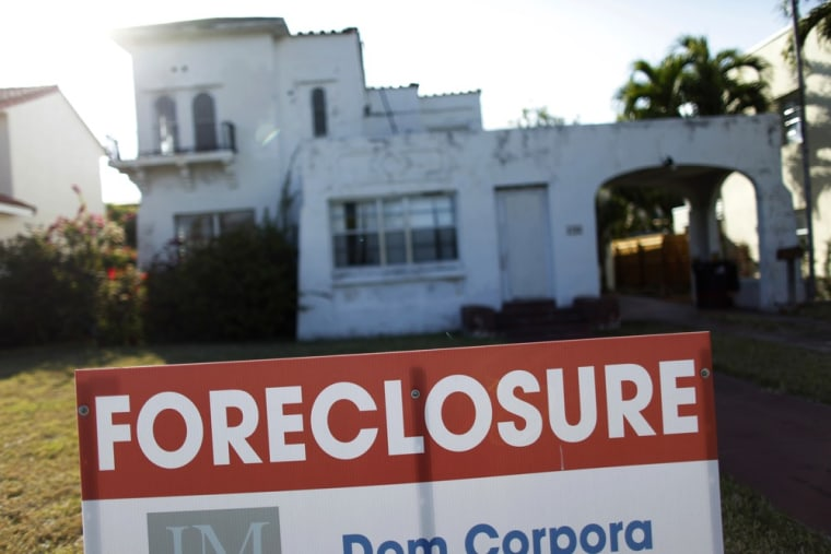 A foreclosure sale sign sits in front of a house in Miami Beach, Florida in this file photo taken February 27, 2009.