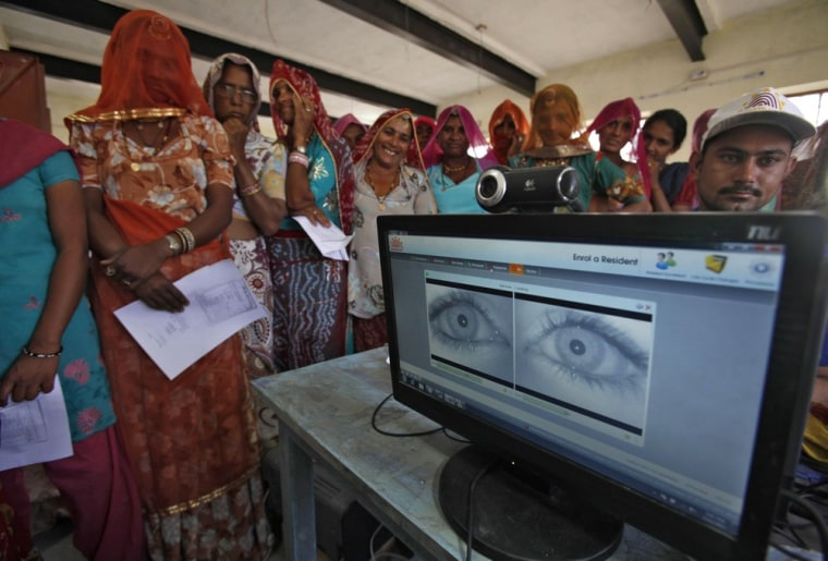 Village women stand in a queue to get themselves enrolled for the Unique Identification (UID) database system at Merta district in the desert Indian state of Rajasthan on February 22. In a more ambitious version of programmes that have slashed poverty in Brazil and Mexico, the Indian government has begun to use the UID database, known as Aadhaar, to make direct cash transfers to the poor, in an attempt to cut out frauds who siphon billions of dollars from welfare schemes.