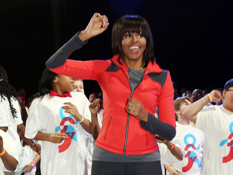 First lady Michelle Obama dances with school children during a debut of a school exercise program on Feb. 28 in Chicago.