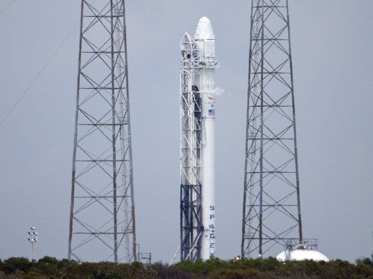 SpaceX's Falcon 9 rocket sits on its launch pad at Cape Canaveral Air Force Station during Monday's pre-launch engine test. The rocket is due to loft a Dragon cargo capsule to the International Space Station on Friday.