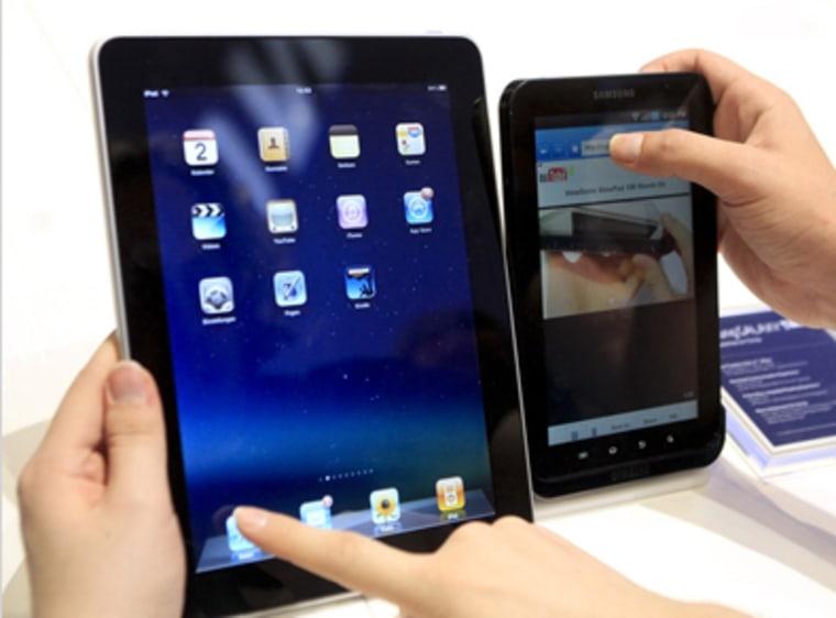Apple iPad, left, and Samsung Galaxy tablet