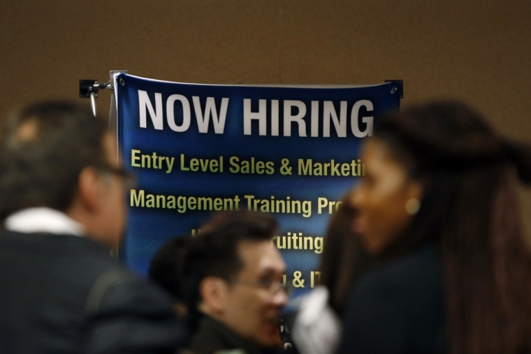 Job seekers stand in line to meet with prospective employers at a career fair in New York City in this file photo taken October 24, 2012.