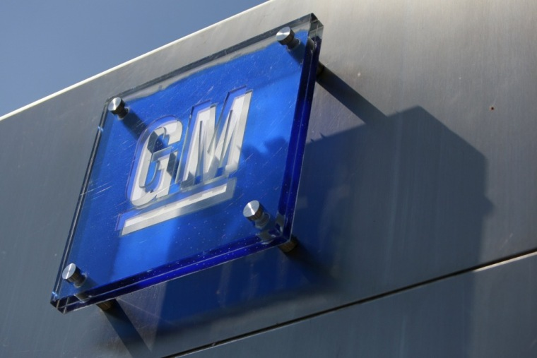 The General Motors logo is seen outside its headquarters at the Renaissance Center in Detroit, Michigan in this file photograph taken August 25, 2009.