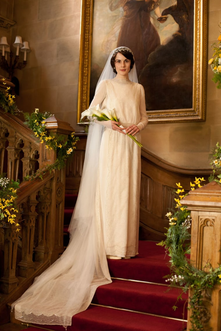 Lady Mary Crawley (played by British actress Michelle Dockery) poses in her pricey wedding gown.