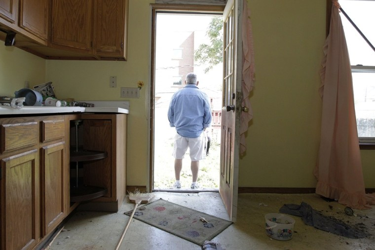 Joseph Keller stands outside the kitchen door of his abandoned house in Columbus, Ohio, September 30, 2012.
