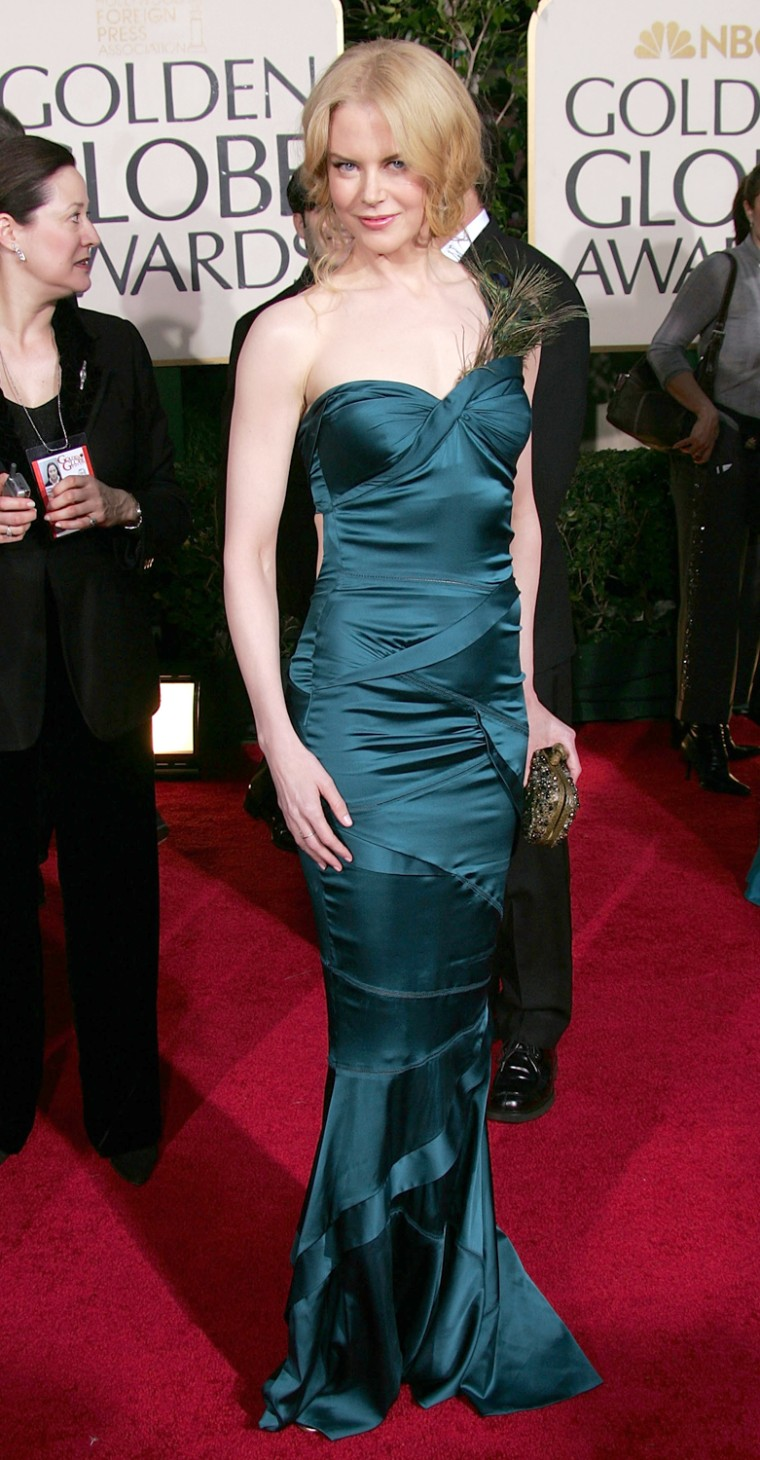 e5f286c122 Nicole Kidman chose a glamorous tealblue satin dress by Gucci for the 2005 golden  Globe Awards