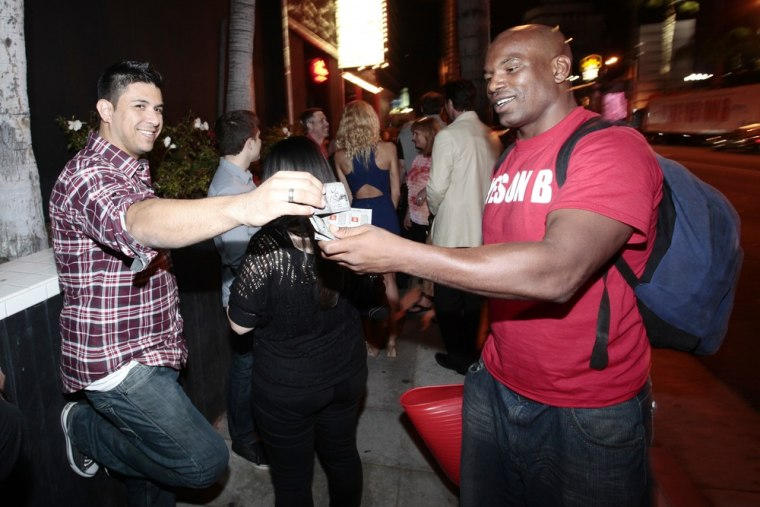 Supporters of Vote Yes on B hand out voter information and free condoms on the famed Sunset Strip on Oct 27, 2012, in Los Angeles.