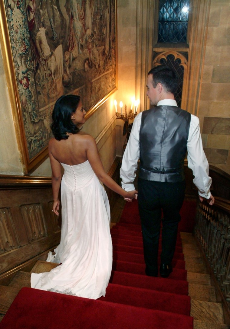 Sunita Gale and her husband descend down Highclere Castle's majestic staircase.