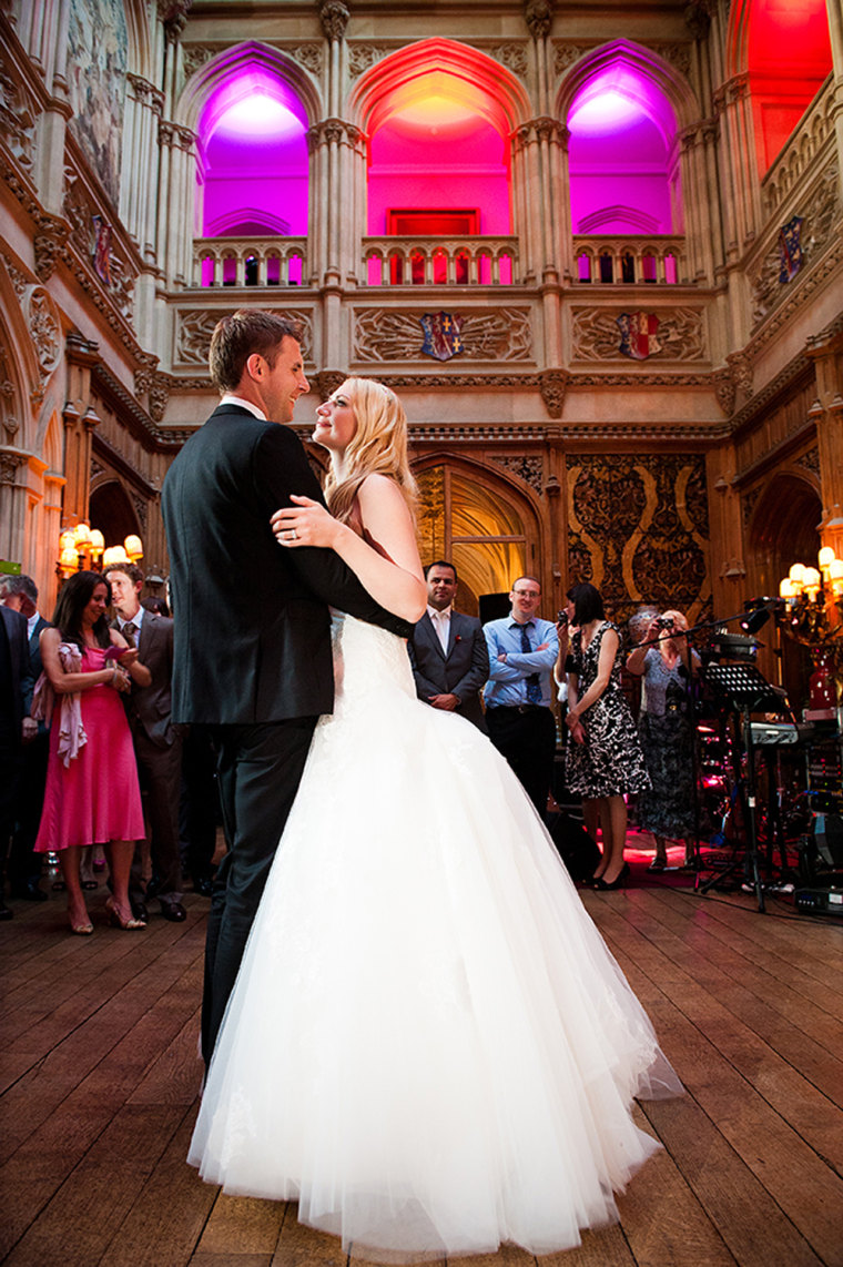 Sarah and Steve Ashley dance together at their Highclere Castle wedding.