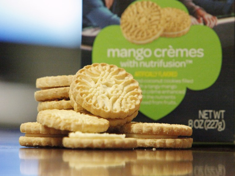 "Mango crèmes are the newest cookies to become a part of the Girl Scout collection. They're vanilla and coconut cookies filled with mango-flavored crème that claims to have ""nutrients derived from fruits."""