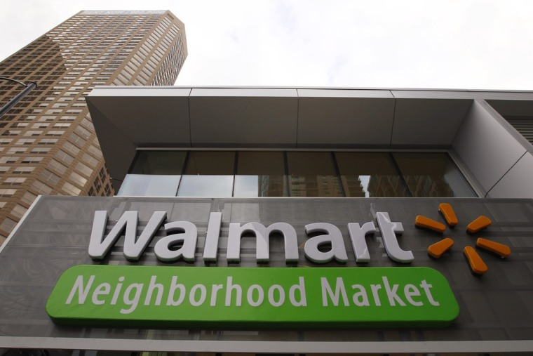 A Walmart Neighborhood Market sign is seen outside a newly opened store in Chicago September 21, 2011. Wal-Mart is experimenting with a similar small ...