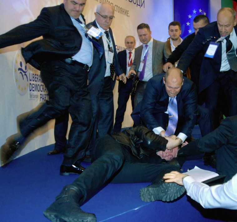 Delegates beat and kick Oktai Enimehmedov after he attacked Ahmed Dogan.