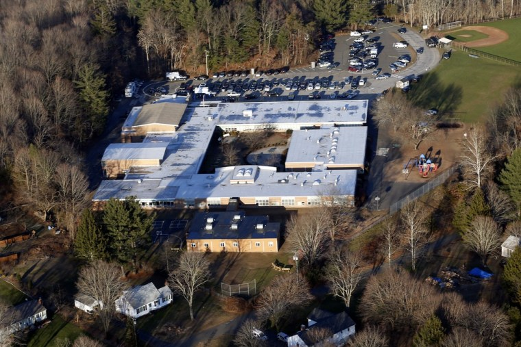 This aerial photo shows Sandy Hook Elementary School in Newtown, Conn., the site of the Dec. 14 shooting that left 20 children and six staffers dead. As residents weigh in on the future of the building, students are attending school at a different facility.