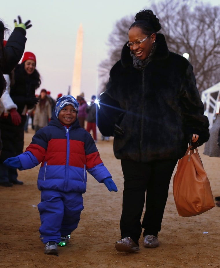 People smile as they enter the National Mall for the ceremonial swearing-in ceremonies on the West front of the U.S. Capitol.