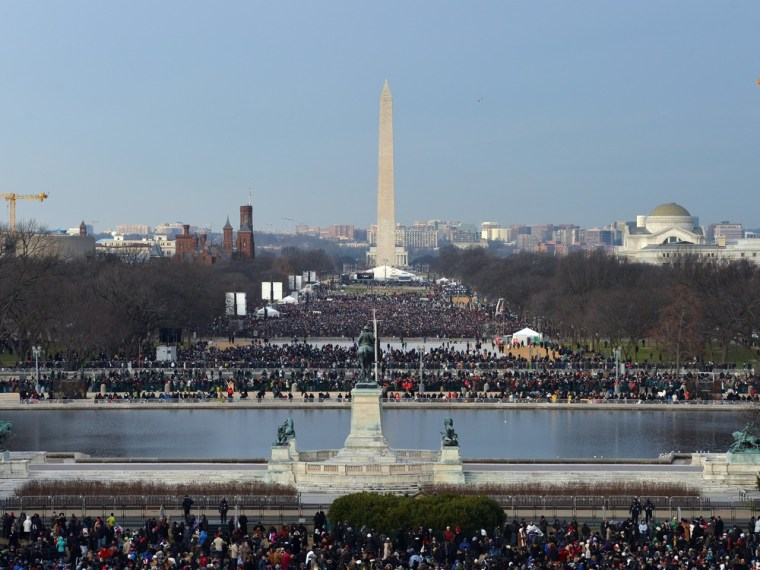 People crowd the National Mall ahead of President Barack Obama's inauguration ceremony at the US Capitol on January 21, 2013 in Washington, D.C.