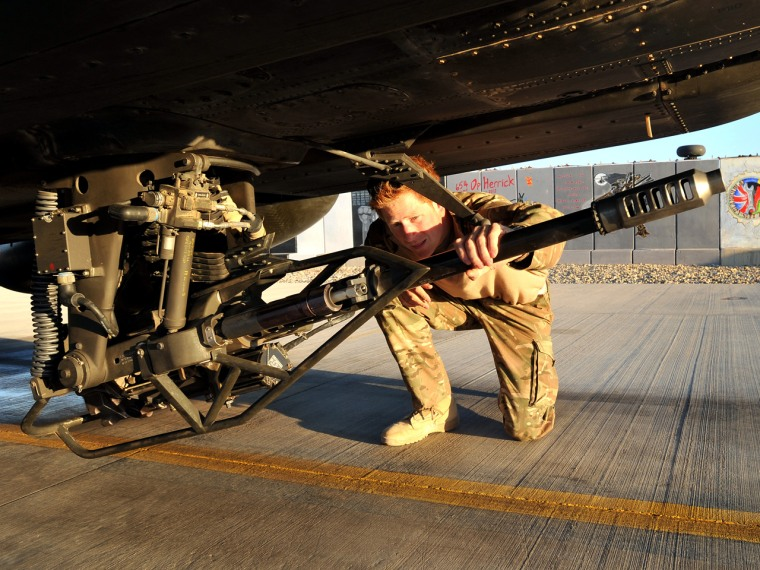 Prince Harry, pictured in January of 2012, doing a pre-flight check of his Apache helicopter.