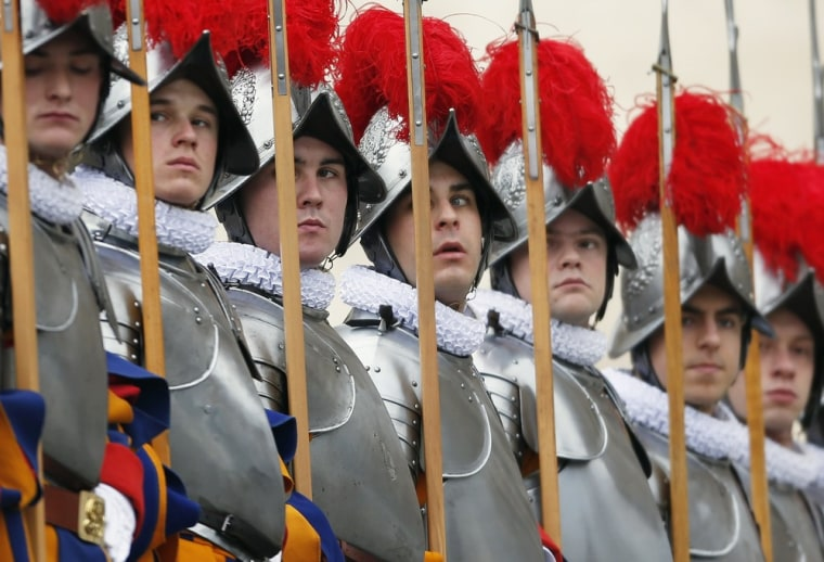 Swiss Guards stand before Pope Benedict XVI makes an address from a balcony in St. Peter's Square in the Vatican City on Dec. 25, 2012.