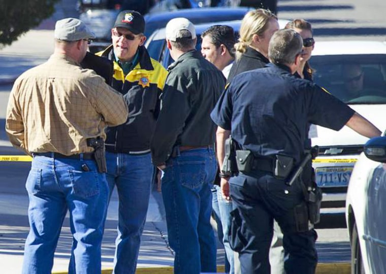 Law enforcement officials confer during a shooting investigation in Boulder City, Jan. 21, 2013.