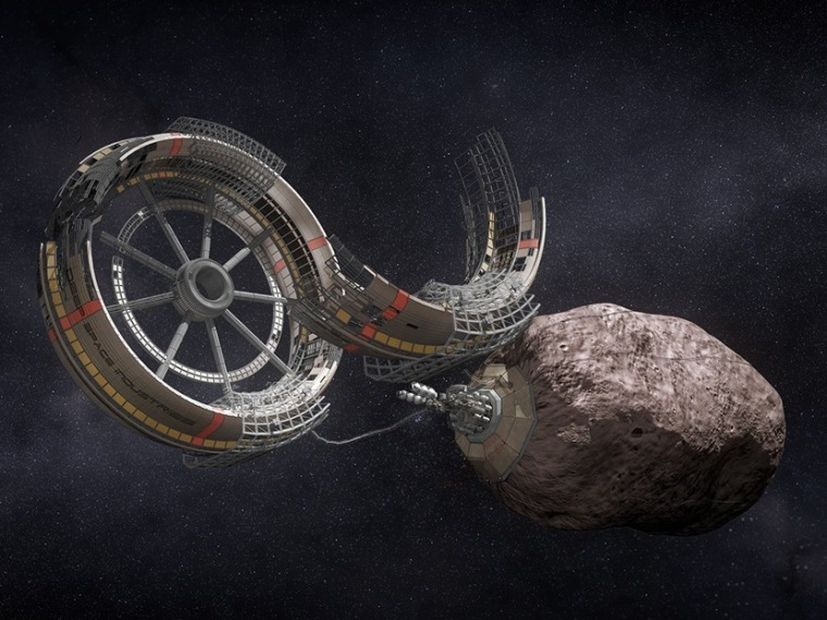 An artist's conception shows a settlement taking shape as part of an asteroid mining operation.