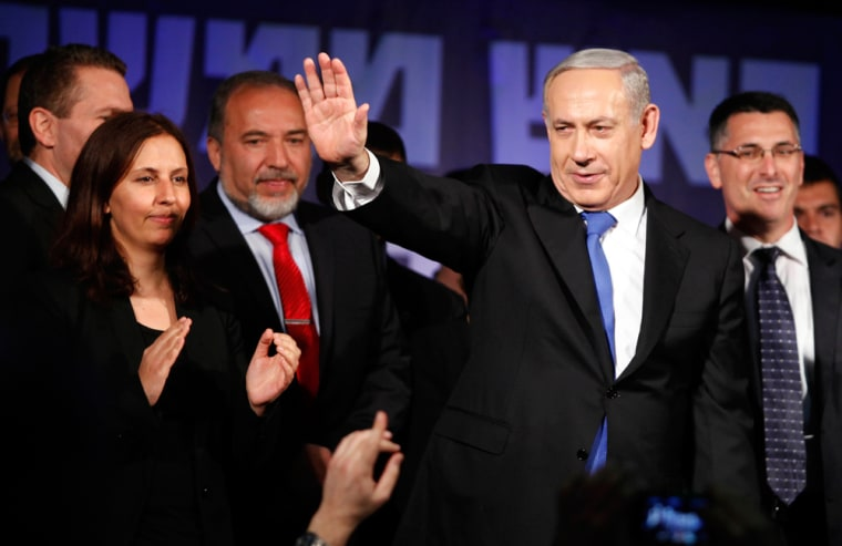 Israeli Prime Minister Benjamin Netanyahu waves to supporters at his election campaign headquarters early Wednesday morning in Tel Aviv. Exit polls indicate that Netanyahu was re-elected for a third term and will return to office. Israel had the highest turnout of voters since 1999.