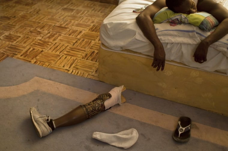 Professional dancer Georges Exantus sleeps as his prosthetic limb lays on the floor in his bedroom in Port-au-Prince, Haiti. Exantus thought he'd never dance again. He was lucky just to be alive. The earthquake three years ago in Haiti's capital flattened the apartment where he was living, where he spent three days trapped under a heap of jagged rubble. After friends dug him out, doctors amputated his right leg just below the knee. Exantus says he has learned to ignore the long stares and quiet whispers, products of a longstanding stigma in Haiti for people with disabilities. Before the quake, few resources existed to accommodate Haiti's disabled, and many regard people with disabilities as misfits.