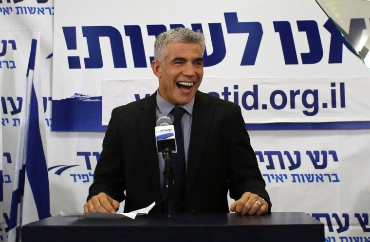 Yair Lapid, leader of the Yesh Atid (There is a Future) party, addresses supporters at his party's headquarters in Tel Aviv on Wednesday. The surprise star of Israel's election is a former television news anchor whose centrist party soared to second place in the balloting.