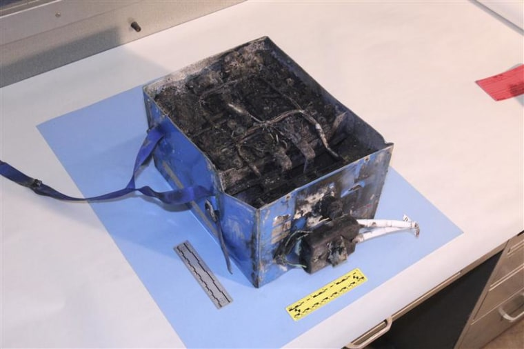 The damaged auxiliary power unit battery removed from a Japan Airlines Boeing 787 Dreamliner jet is seen in this handout photo provided by the U.S. National Transportation Safety Board.