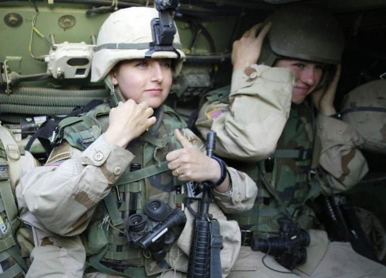 Female soldiers from the US 1st Cavalry are pictured on patrol in Baghdad's al-Jihad quarter in this March 21, 2004, file photograph.