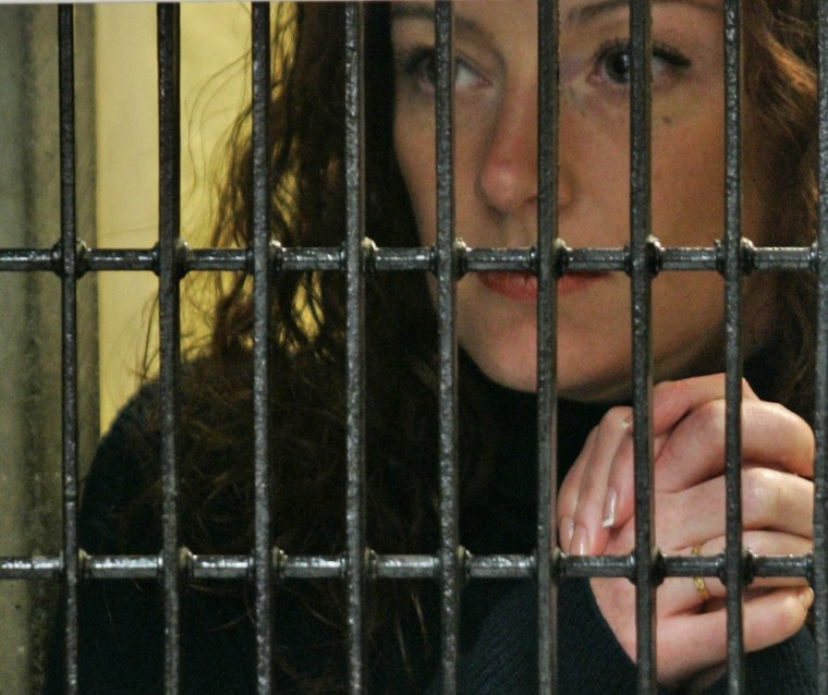 French national Florence Cassez listens to her lawyer behind bars on Jan. 22, 2008 in Mexico City. Mexico's Supreme Court ordered yesterday, the immediate release of Cassez serving 60 years in prison for kidnapping, ruling that authorities had violated her legal rights.
