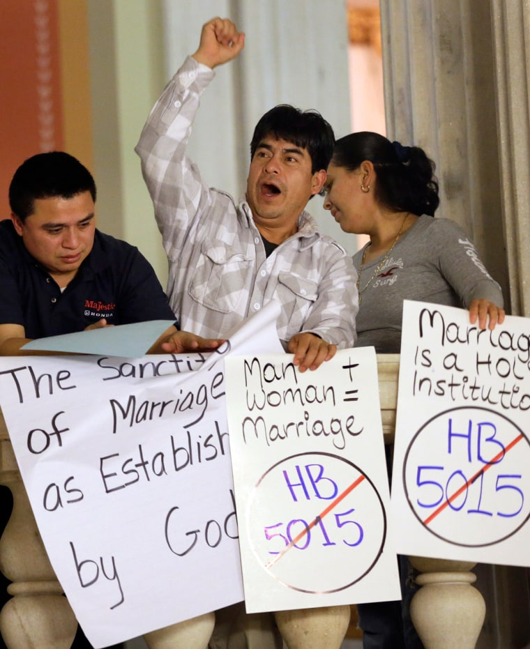 Demonstrators opposed to same-sex marriage during a rally at the Statehouse, in Providence, R.I. on Tuesday.