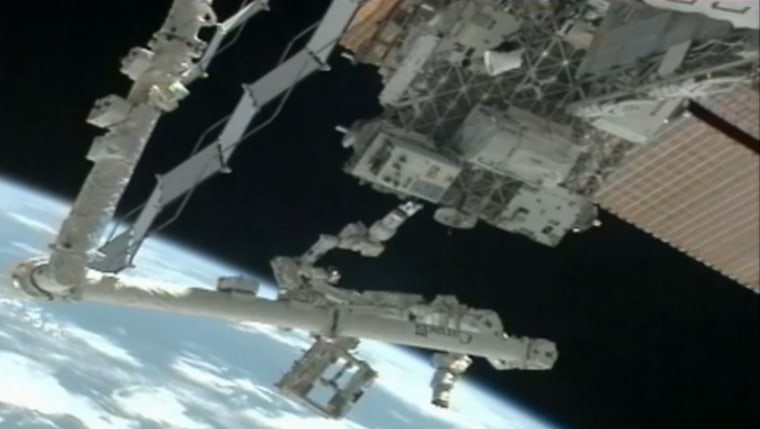 The Dextre robot on the International Space Station is seen near the Robotic Refueling Mission testbed outside the International Space Station in this camera view in January 2012.