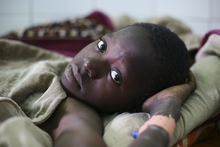 Manjou Cisse, 13, was wounded by shrapnel during fighting in Diabaly, which was recently liberated by French troops.