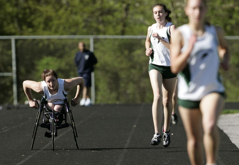 Wheelchair athlete Tatyana McFadden, 16, races along side other runners in her first track meet along side able-bodied high school runners in Rockville, Md.