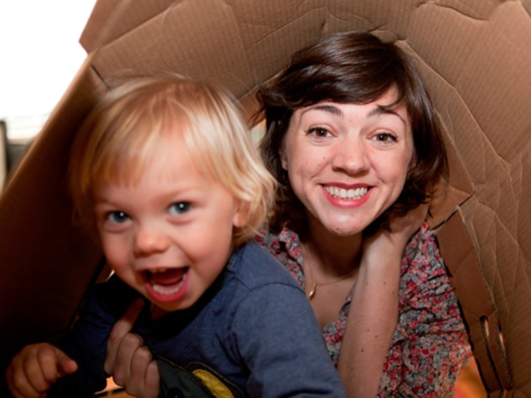 Hattie Garlick, who has taken a no-spending vow for 2013, plays with her 2-year-old son Johnny in a cardboard box.
