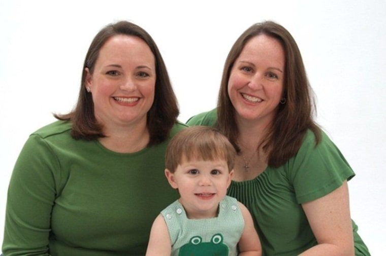 Ashley Broadway, left, is pictured with her wife, Lt. Col. Heather Mack and their 2-year-old son.