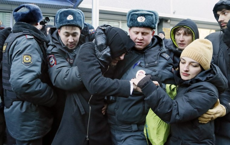 Russian Interior Ministry officers detain two gay rights activists during an unsanctioned protest in front of the Duma, Russia's lower house of parliament, in Moscow on Friday.