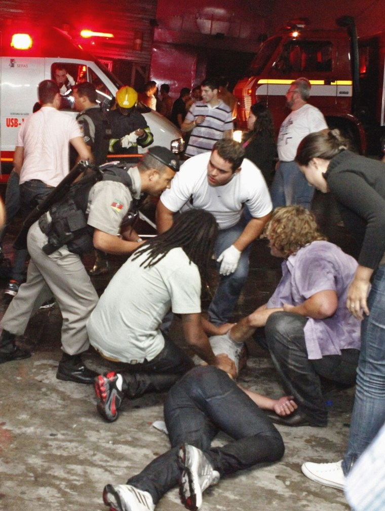 People help a man injured in a nightclub fire in Santa Maria city, Brazil, on Sunday.