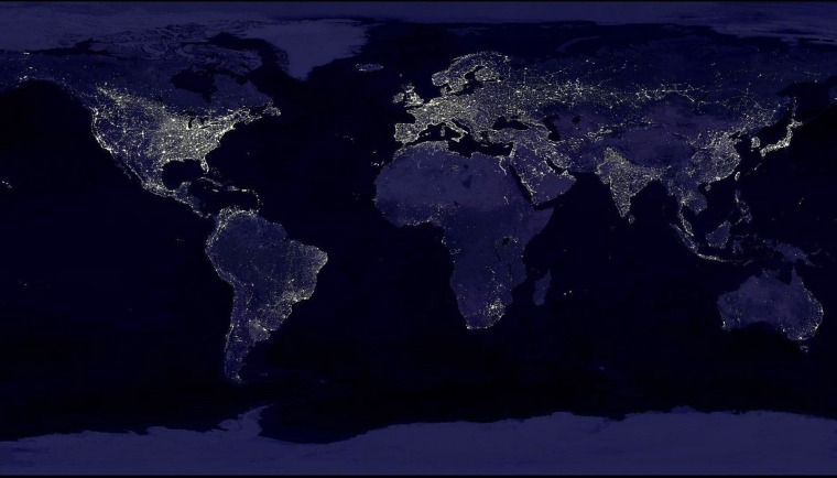 This composite image shows a global view of Earth at night, compiled from over 400 satellite images. New research shows that major cities, which generally correspond with the nighttime lights in this image, can have a far-reaching impact on temperatures.