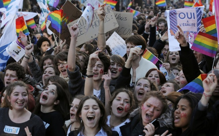Demonstrators march through the streets of Paris in support of the French government's draft law to legalize marriage and adoption for same-sex couples, Jan. 27.