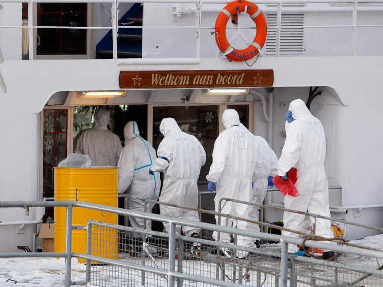 Paramedics dressed in protective attire enter a German cruise ship quarantined in December after an outbreak suspected to be norovirus. A new strain is making people miserable around the world this year.