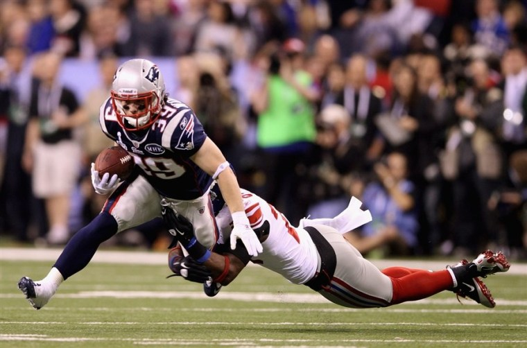 In this file photo running back Danny Woodhead of the New England Patriots fights off a tackle in the Super Bowl on Feb. 5, 2012. The game was the most watched television broadcast in U.S. history.