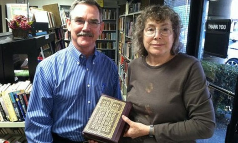 Joanne Murphy, right, is a library booster and former emergency room physician who realized that an old Bible had belonged to baseball great Branch Rickey, who broke the color barrier by hiring Jackie Robinson for the then-Brooklyn Dodgers. At left, Rickey's grandson, Christopher Jakle.