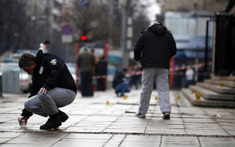 An investigator works at the crime scene where Zlatomir Ivanov was shot in downtown Sofia on Jan. 29, 2013.