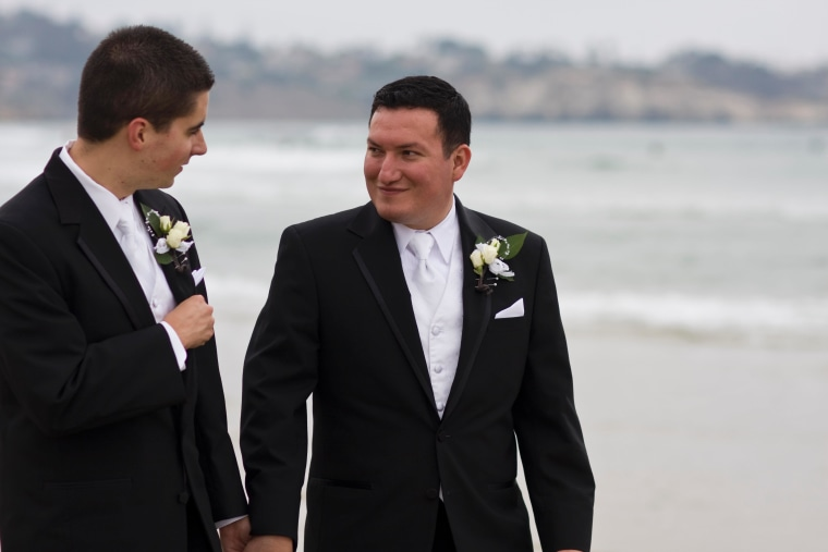 Carlo Joyce, right, and Thomas Joyce share a moment on their wedding day on July 10, 2010.